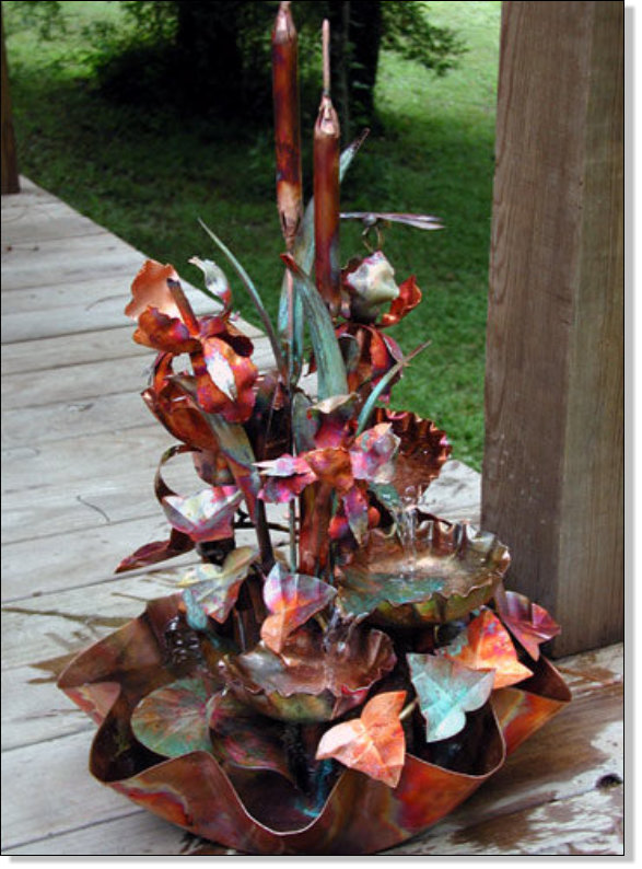 Four tiered copper fountain with three irises